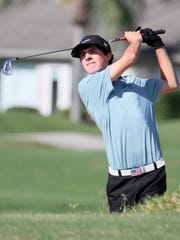 Peter George of Gulf Coast hits out of a bunker in the Class 3A-Region 5 tournament at Kingsway Country Club in Lake Suzy on Monday, Oct. 17, 2016.