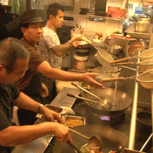 Inside the kitchen of Indochine in Downtown Jacksonville. Chefs prepare meals for customers during Tuesday's lunch rush.