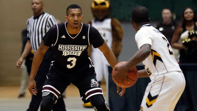Mississippi State guard Xavian Stapleton (3) sets up to defend the goal against Southern Mississippi guard D'Angelo Richardson (2) in the second half of an NCAA college basketball game in Jackson.