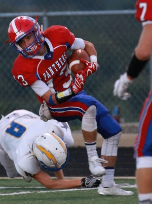 Wide receiver, Gunnar Carpenter, side steps Brayden Coler of Philo after making an impressive catch. Licking Valley hosted Philo Friday night. Licking Valley won in the last seconds of the game with a 19-yard field goal as the time expired. Final score was 22-20.
