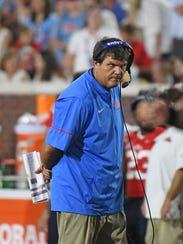 Mississippi head coach Matt Luke watches on during