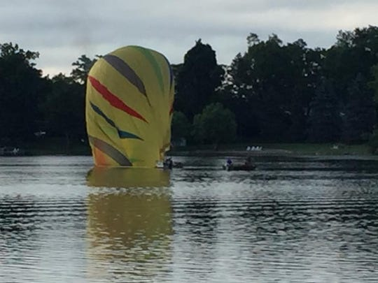 A hot air balloon crashes Thompson Lake after hitting power lines in Howell Sunday morning.