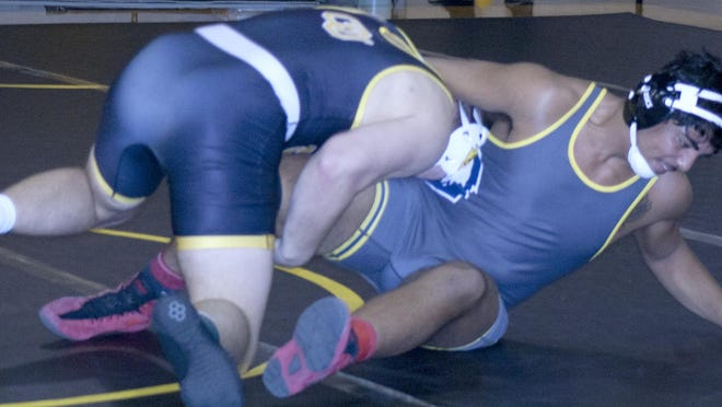 Ottawa University sophomore Carson Savage, 197 pounds, grabs a leg looking to turn his foe onto his back. Savage was one of five Braves to garner a pin in a dual win Thursday over Oklahoma Wesleyan.