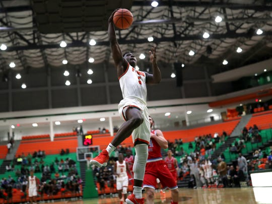 FAMU's Nasir Core dunks the ball on a fast break against Delaware State at the Al Lawson Center on Monday, Jan. 15, 2018.