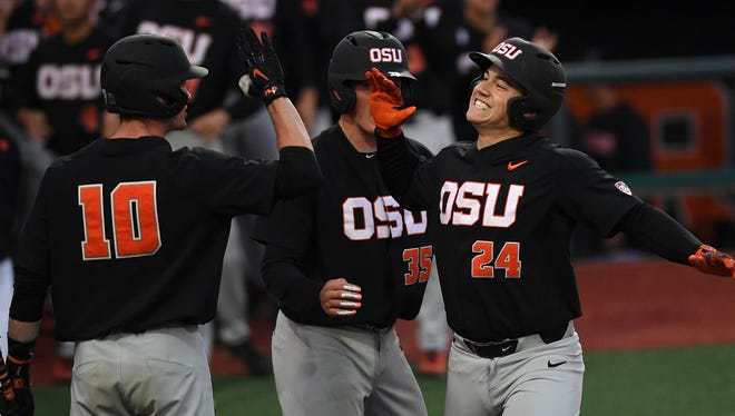 Oregon State's K.J. Harrison (24) celebrates after hitting a two-run home run against the Yale Bulldogs during the third inning of an NCAA baseball tournament regional game June 3 in Corvallis, Ore.