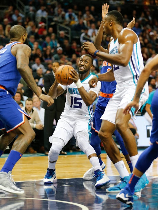 Charlotte Hornets guard Kemba Walker (15) tries for two points against the New York Knicks during the first half of an NBA basketball game, Monday, Dec. 18, 2017, in Charlotte, N.C. (AP Photo/Jason E. Miczek)