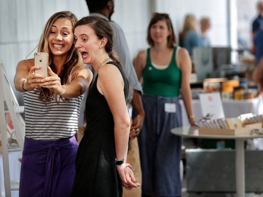 June 21, 2016 — Jewelry makers Ashley Parrish (left) and Sarah Brubaker take a selfie at their booth outside of City Hall during the Memphis Maker Fair featuring wares from local artists and artisans sponsored by the organization Made By Project. (Jim Weber/The Commercial Appeal)