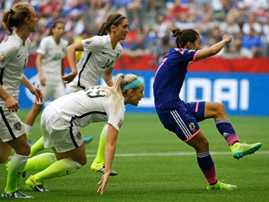 Japan's Yuki Ogimi, right, scores a goal as United States' Julie Johnston, (19) and other players look on during the first half of the FIFA Women's World Cup soccer championship in Vancouver, British Columbia, Canada, Sunday, July 5, 2015.