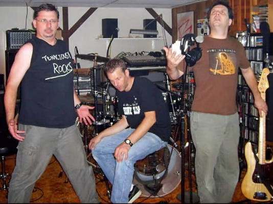 These guys from Mean Man don t look so mean. In fact they look a little . . . confused. Especially that guy in the center. From left to right:  The Optic Nerd  aka A.J. Shue,  Truk  aka Kurt Golden and  Tonar  aka Tom Traina.