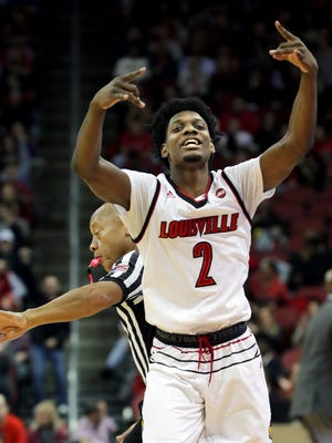 Louisville's Darius Perry accidentally bumps into a ref while celebrating.