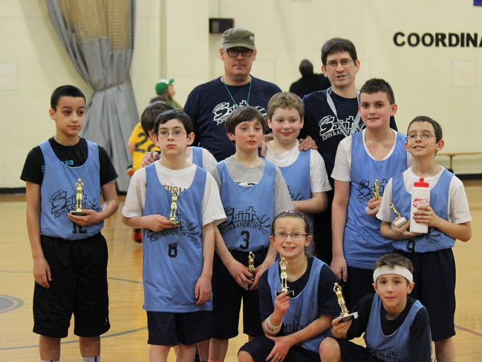 Jeff King, on right in rear, coached the Sts. John and Andrew CYO basketball team last year
