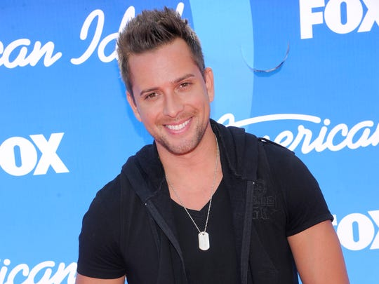 """FILE - In this May 16, 2013, file photo, former contestant David Hernandez arrives at the """"American Idol"""" finale in Los Angeles."""