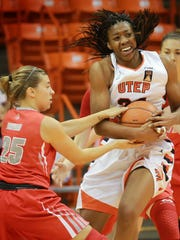 UTEP'S Lawna Kennedy, right, tries to fend off New