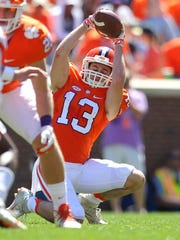 Clemson wide receiver Hunter Renfrow (13) catches a snap as a placekick holder during the Tigers' spring game on April 8.