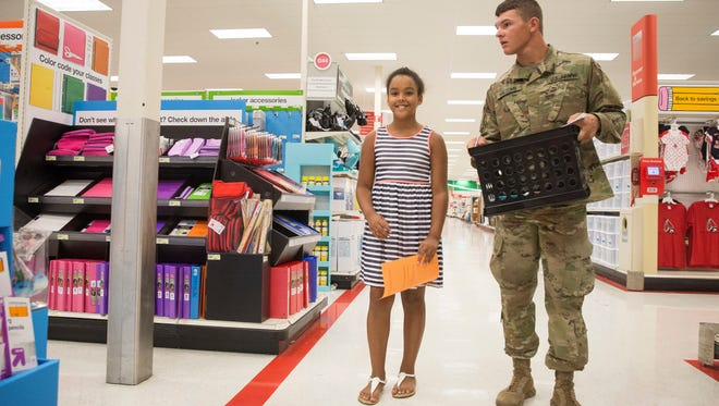 Police officers, firefighters, EMTs and military officers helped kids shop for back-to-school supplies with money raised by Muncie Crime Stoppers on Saturday at the local Target for the annual Back-to-School Heroes and Helpers event. The event saw dozens of volunteers pair with nearly 100 kids for the event.