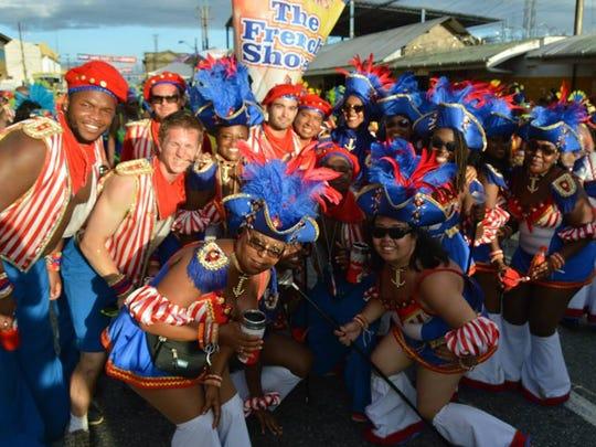 Alex Suarez, center, dons a traditional-Carnival costume