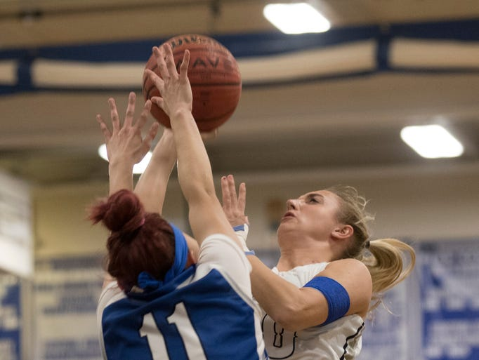 Dara Babrey goes up with shot against Lincoln's Central