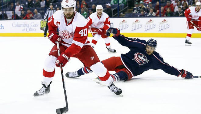 Red Wings left wing Henrik Zetterberg (40) controls the puck against Blue Jackets defenseman Seth Jones (3) in the first period at Nationwide Arena Thursday.