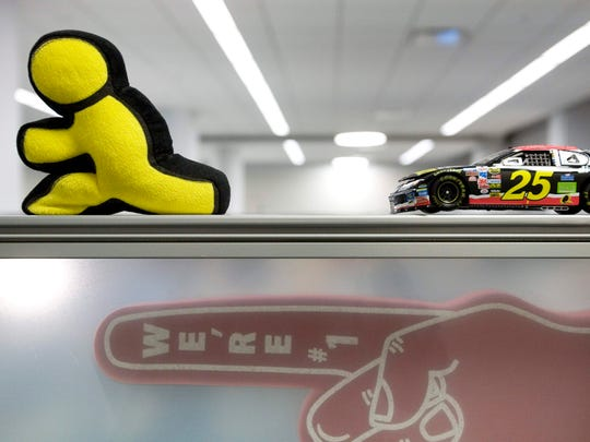 In this May 12, 2008 file photo, the AOL Running Man figure decorates an employee's cubicle in AOL's New York office.