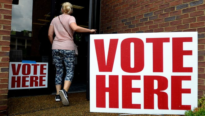 A woman enters the Boy Scouts of America polling location to vote on Thursday, August 2, 2018, in Nashville, Tenn.  The General Election is Nov. 6.