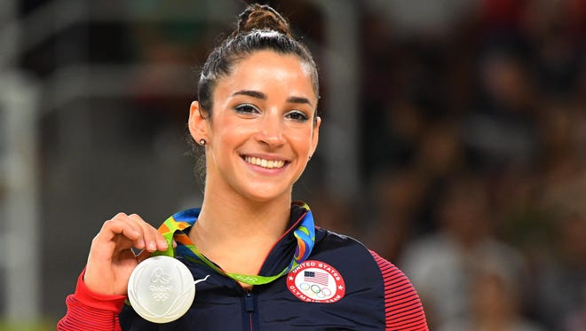 Aly Raisman celebrates after winning a silver medal during the women's floor exercise final in the 2016 Rio Olympics.