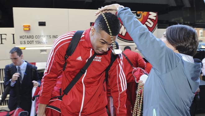 UL wide receiver Jared Johnson, shown here receiving New Orleans Bowl beads in 2014, is back after undergoing knee surgery.