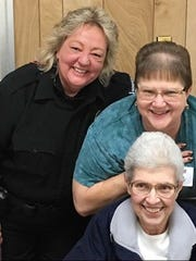 """York County 911 Center's """"Deadly Dynamic Duo"""" was Joanne Borgel (bottom) and Cheri Gibbs Klinedinst (middle), taken at a 2016 911 dispatcher reunion. At upper left is Casey Cassell."""