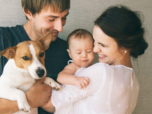 Family with baby and pet dog