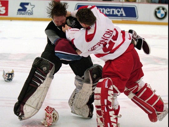 Even goaltenders Patrick Roy (Avalanche), left, and Mike Vernon (Red Wings) got in on the fisticuffs March 26, 1997.