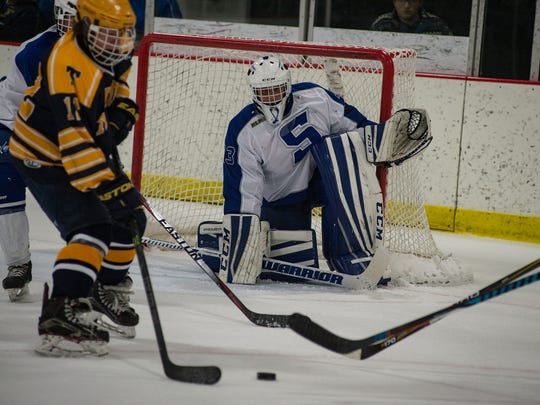 Lined up for the shot by Trenton's Drew Welsch (No. 12) is Salem senior goalie Tristan Rehling (No. 33).