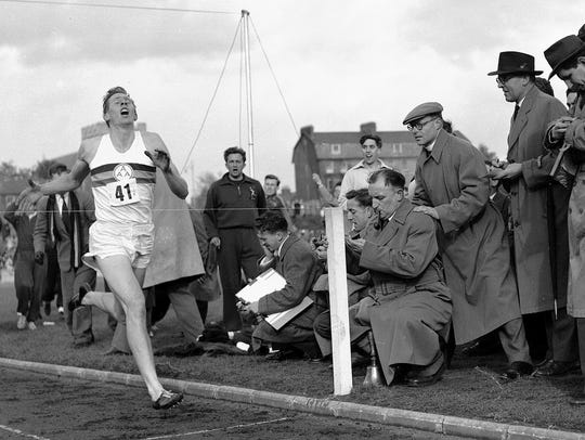 Roger Bannister crosses the finish line on May 6, 1954,