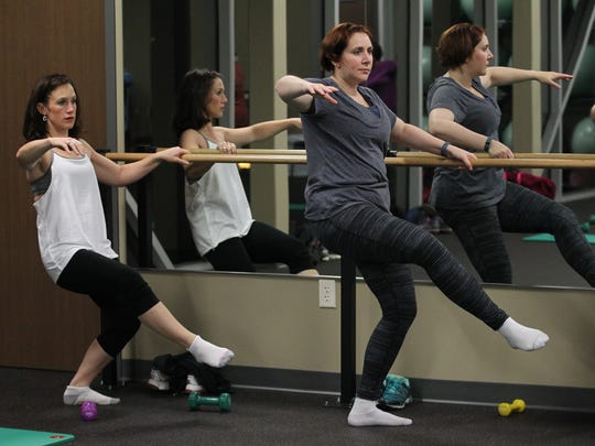 Carrie Hutton, left, and Laura Scudiere participate in a barre class Nov. 6 at the Woodson YMCA in Wausau.