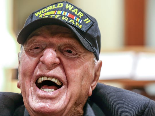 99-year old World War II Veteran Sidney Walton laughs