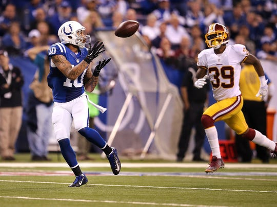 Colts wide receiver Donte Moncrief (10) catches a 48-yard touchdown pass as he burns Redskins cornerback David Amerson (39) Nov. 30, 2014.