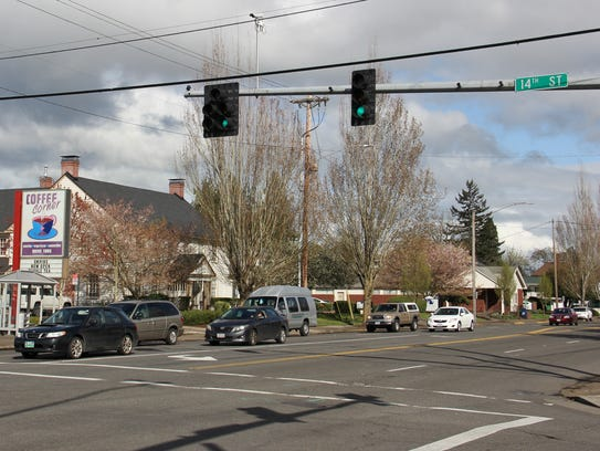 Motorists drive along State Street in Salem on Tuesday, April 10, 2018. A proposed re-design of the street calls for portions of the road between around 14th and 17th streets to slim from two lanes each way to one lane each way with a center turn lane.