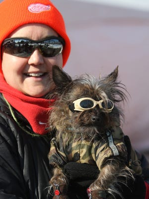 Lisa Janmon and her Chorkie Dexter all dressed up for the Palmer Park Doggie Walk and Fashion show Saturday, Jan. 31, 2015 in Detroit.