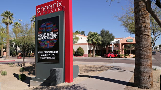The view of the Phoenix Theater signage adjacent to the Quality Inn and Suites at McDowell and Alvarado as seen in Phoenix on Feb., 10, 2015