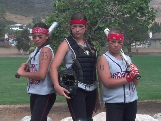 Newbury Park High softball seniors Paige Barth, Serena Huchingson and SeaEnna Satcher have been playing together for years. They were 12 when they posed for this photo at Peppertree Park.