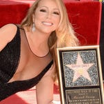 """Mariah Carey has a reason to smile: She finally got a star on the Hollywood Walk of Fame, and """"Empire"""" creator Lee Daniels has offered her a job."""