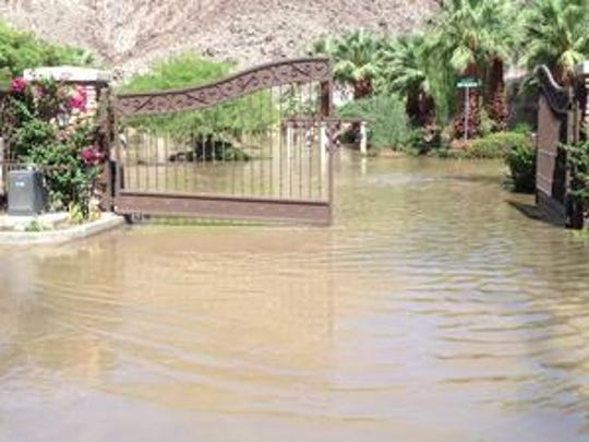 The Hidden Canyon community on Eisenhower Drive in La Quinta was flooded during a September 2014 storm that drenched the valley and damaged several homes and businesses in La Quinta. The city is purchasing a vacant parcel on Eisenhower Drive to be used for storm water retention.
