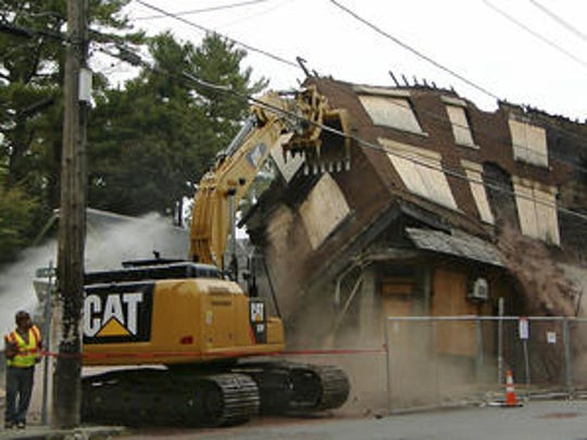 Workers from LCP Group of Vestal demolish the building that contained the Chapter House bar in October 2015.