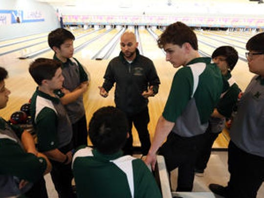 Montville bowling head coach Wayne Guarino talks to