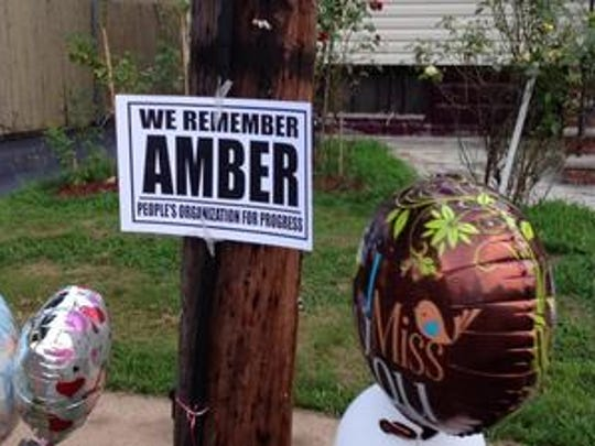 The balloons and poster put up along Hussa Street in Linden in remembrance of Amber Duncan-Wilson, who was killed just days after her 2012 Linden High School graduation.