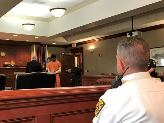 Miquan Hubbard, 19, turns around to address family