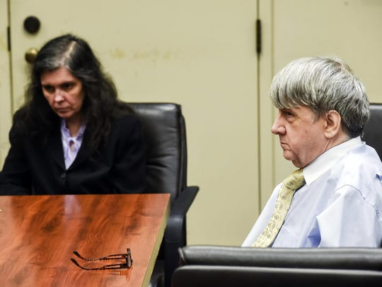 In this Aug. 3, 2018 file photo, Louise Turpin, left, and her husband, David Turpin appear in Superior Court in Riverside, Calif. The Turpins, who starved a dozen of their children and shackled some to beds, face sentencing for years of abuse.