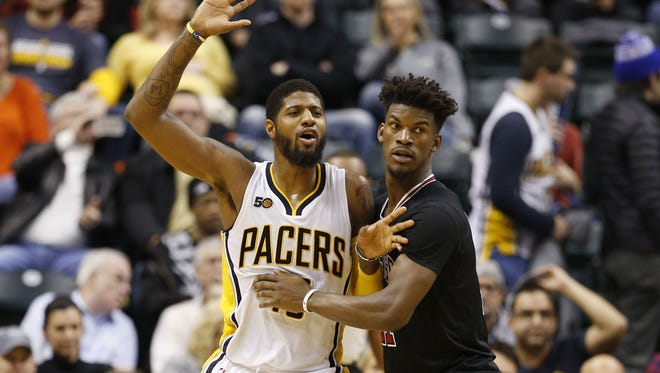Indiana Pacers forward Paul George (13) is guarded by Chicago Bulls guard Jimmy Butler (21) at Bankers Life Fieldhouse. Indiana defeated Chicago 111-101.
