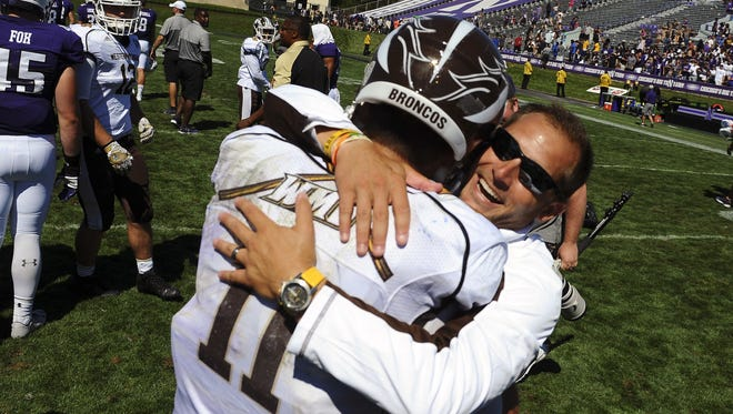 Western Michigan head coach P.J. Fleck hugs quarterback Zach Terrell (11) after beating Northwestern, 22-21, in Evanston, Ill., Sept. 3.