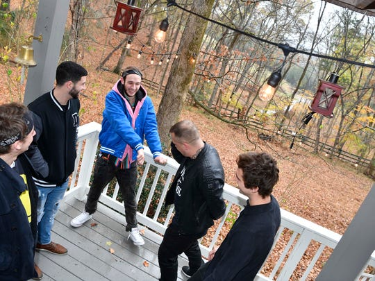 "From left, Matt Royer, Nick Zaioud, Nathan ""Littlefoot"" Fouts, Alexander King and Brad Jennings make some moves as they sing a song on the porch of the studio in Brentwood, Tenn., Wednesday Nov. 15, 2017."