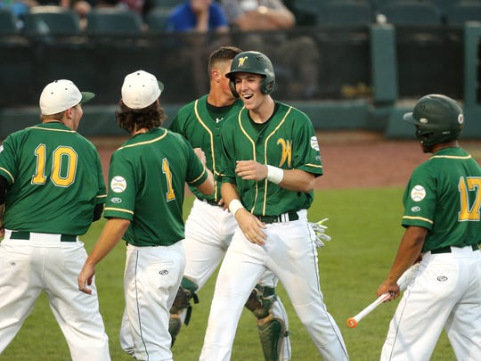 Connor McCaffery celebrates a run in last summer's Iowa state baseball tournament. The Iowa City West junior has a team-leading 20 runs this year, and is showing elite baseball skills to go along with his status as the state's top basketball player in his class.