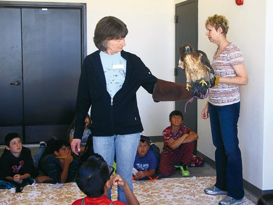 SARAH MATOTT - CURRENT-ARGUS.   Students from Sunset Elementary School were able to see some of New Mexico's birds of prey at the National Cave and Karst Institute in Carlsbad. The presentation was a part of the National Environmental Education Week, coordinated by the Lincoln National Forest.